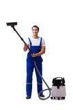 The man in coveralls doing vacuum cleaning on white Royalty Free Stock Image