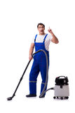 The man in coveralls doing vacuum cleaning on white Royalty Free Stock Photo