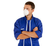 Man in coveralls and protective mask Royalty Free Stock Image