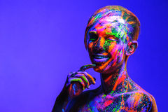 Man covered with fluorescent paint Royalty Free Stock Image