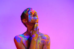 Man covered with fluorescent paint Royalty Free Stock Images