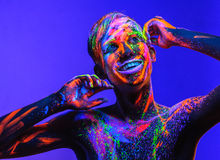 Man covered with fluorescent paint Royalty Free Stock Photo