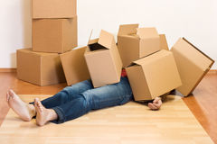 Free Man Covered In Cardboard Boxes - Moving Concept Stock Images - 9035804