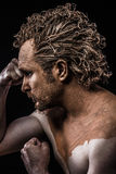 Man covered in mud and naked royalty free stock photos