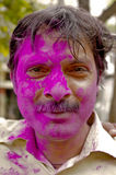 Man covered with paint for Holi festival Stock Photo