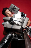Man covered with presents Stock Photography