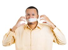 Man covering closed taped mouth Royalty Free Stock Photo