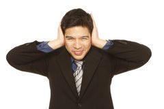 Man Covering Ears Stock Photos