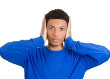 Man covering ears Stock Image