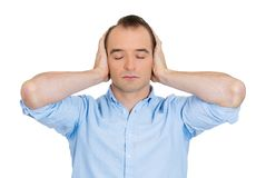 Man covering ears Royalty Free Stock Image