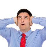 Man covering ears because of loud noise Stock Photos