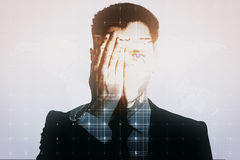 Man covering eye on map background. Young man closing one eye with hand on light mesh background with map Royalty Free Stock Images