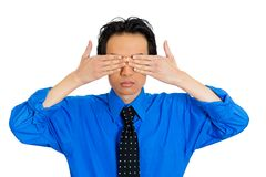 Man covering eyes Stock Image