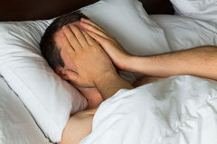 Man Covering Eyes with Hand Stock Image