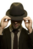 Man covering eyes with hat. Studio shot of man covering eyes with hat Stock Images