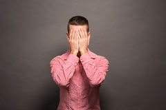 Man covering eyes his face Stock Image