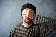Man covering eyes Royalty Free Stock Images