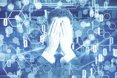 Man covering face on digital wallpaper. Businessman covering face on abstract digital wallpaper Stock Photography