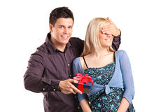 Man covering girlfriend's eyes to surprise her Royalty Free Stock Photos