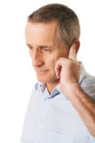 Man covering his ear Royalty Free Stock Image