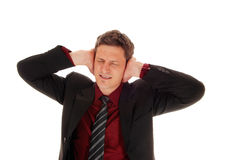 Man covering his ear's. Royalty Free Stock Image