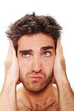 Man covering his ears Stock Images