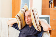 Man covering his ears Stock Photography