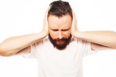 Man covering his ears by hands Stock Photo