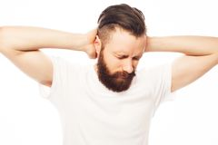 Man covering his ears by hands Stock Photography