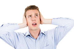 Man covering his ears looking up, headache from loud noise Stock Photography