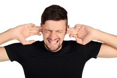 Man covering his ears. Royalty Free Stock Photos