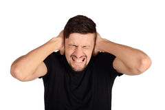 Man covering his ears. Royalty Free Stock Image