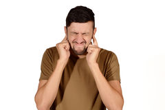 Man covering his ears. Stock Photography