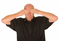 Man covering his eyes Stock Images