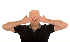 Man covering his eyes Stock Photography