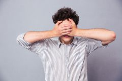 Man covering his eyes Royalty Free Stock Image