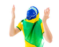 Man covering his face with the Brazilian flag Royalty Free Stock Photos