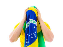 Man covering his face with the Brazilian flag Royalty Free Stock Images