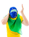 Man covering his face with the Brazilian flag Stock Images