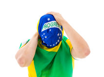 Man covering his face with the Brazilian flag Royalty Free Stock Photo