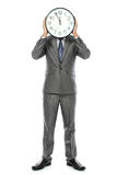 Man covering his face with clock Royalty Free Stock Photo