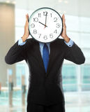 Man covering his face with clock Stock Photography