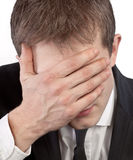 Man covering his face by hand Stock Images