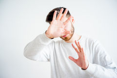Man covering his face Royalty Free Stock Image
