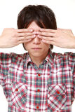 Man covering his face with hands Royalty Free Stock Image