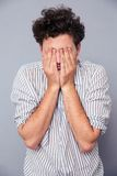 Man covering his face with palms Royalty Free Stock Photography