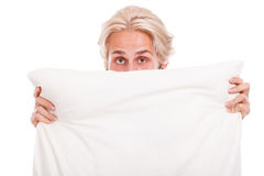 Man covering his face with pillow Royalty Free Stock Photos