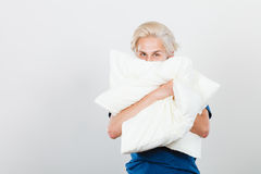 Man covering his face with pillow Stock Image