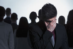 Man covering his face Stock Image