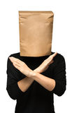 Man covering his head using a paper bag. arms crossed Royalty Free Stock Images